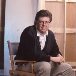 John Hughes in his director's chair in 1990