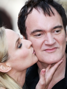 Diane Kruger kisses director Quentin Tarantino on the cheek during the London permiere of &#8216;Inglourious Basterds&#8217; at the Odeon Leicester Square on July 23, 2009