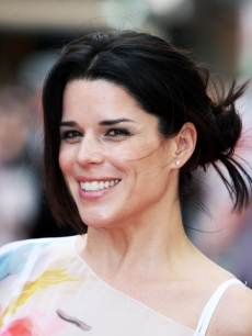 Neve Campbell is all smiles at the London premiere of 'Inglourious Basterds' at the Odeon Leicester Square on July 23, 2009