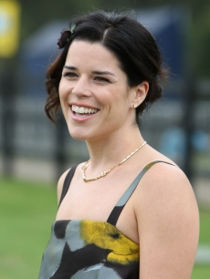 Neve Campbell shows her smile at the Cartier International Polo Day at Guards Polo Club in Egham, England on July 26, 2009