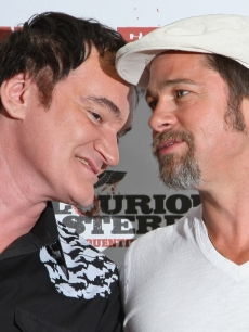 Director Quentin Tarantino and Brad Pitt share a moment on the red carpet during a photocall for &#8216;Inglourious Basterds&#8217; at the Adlon Hotel in Berlin, Germany on July 28, 2009 