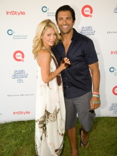 Kelly Ripa and Marc Consuelos strike a pose at QVC's Super Saturday Live at Nova's Ark Project in Water Mill, New York, on August 1, 2009