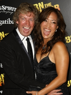 "'So You Think You Can Dance' judge Nigel Lythgoe and ""DWTS"" judge Carrie Ann Inaba share a laugh during the after party for the opening night of Broadway's 'Burn The Floor' in New York City on August 2, 2009"