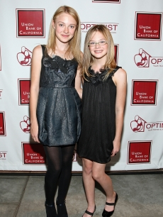 Dakota Fanning and Elle Fanning arrive at The Optimist Youth Homes & Family Services' 2008 Mentor Awards Dinner and Fashion Show held at the Globe Theater in Universal City, California on October 22, 2008