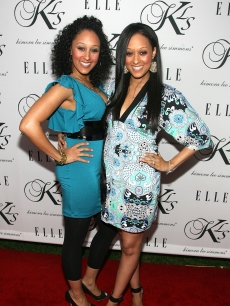 Tamera Mowry and Tia Mowry arrive at Kimora Lee Simmons Debuts KLS Collection paty at the Hollywood Social in Hollywood on March 23, 2006