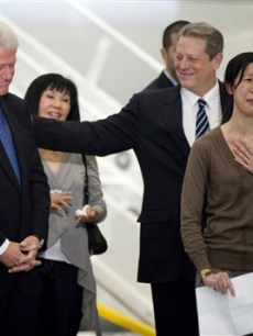 Journalist Laura Ling with former President Bill Clinton and former Vice President Al Gore at the Bob Hope Airport in Burbank, Calif., on Wednesday, August 5, 2009