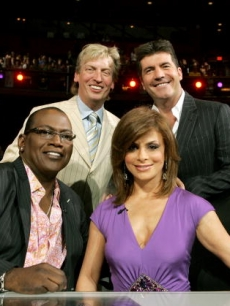 American Idol Executive Producer Nigel Lythgoe poses with the judges Simon Cowell, Randy Jackson and Paula Abdul