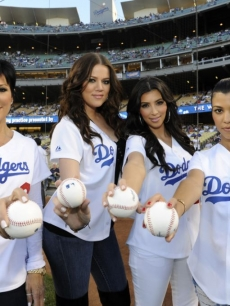 Kris Jenner and Kim, Kourtney and Khloe Kardashian strike a pose on the field during the LA Dodgers game on August 5, 2009