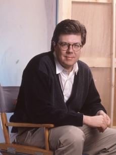 John Hughes in his director&#8217;s chair in 1990